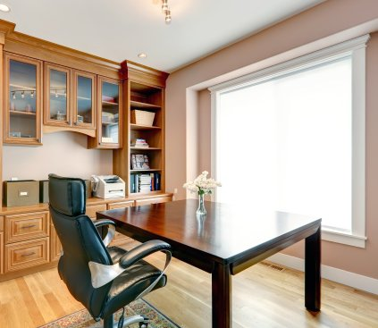 An office space with a chair in center